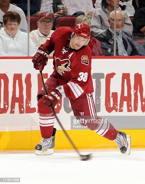 Vernon Fiddler of the Phoenix Coyotes fires the puck up ice against the Colorado Avalanche on April 1 2011 at Jobingcom Arena in Glendale Arizona The...