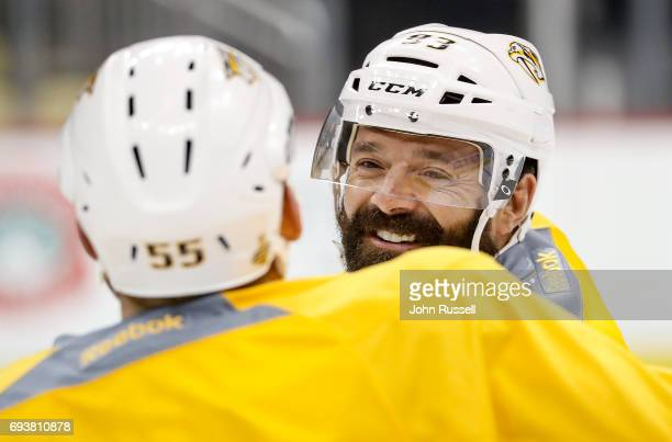 Vernon Fiddler talks with Cody McLeod of the Nashville Predators during morning skate prior to Game Five of the 2017 NHL Stanley Cup Final against...