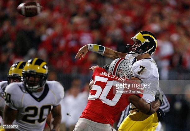 Vernon Gholston of the Ohio State Buckeyes hits quarterback Chad Henne of the Michigan Wolverines as Henne throws the ball November 18, 2006 at Ohio...