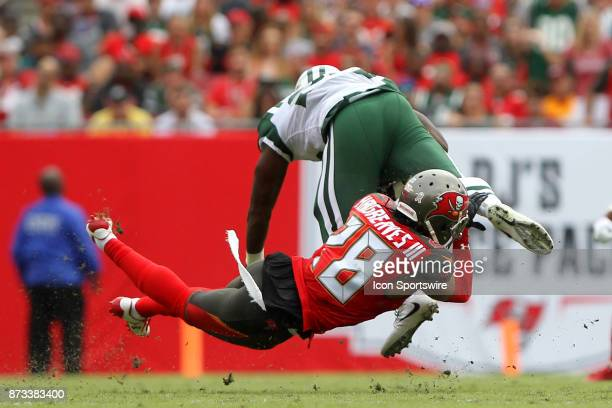 Vernon Hargreaves III of the Bucs dives to bring down Elijah McGuire of the Jets during the regular season game between the New York Jets and the...