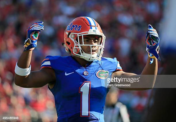 Vernon Hargreaves III of the Florida Gators asks the crowd for noise during the game against the Georgia Bulldogs at EverBank Field on October 31...