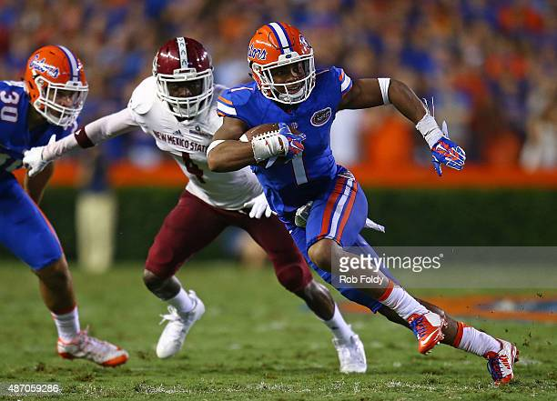Vernon Hargreaves III of the Florida Gators carries the ball for six yards acting as a reciever during the second quarter of the game against the New...