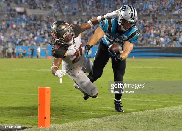 Vernon Hargreaves III of the Tampa Bay Buccaneers forces Christian McCaffrey of the Carolina Panthers out-of-bounds short of the first down marker on...