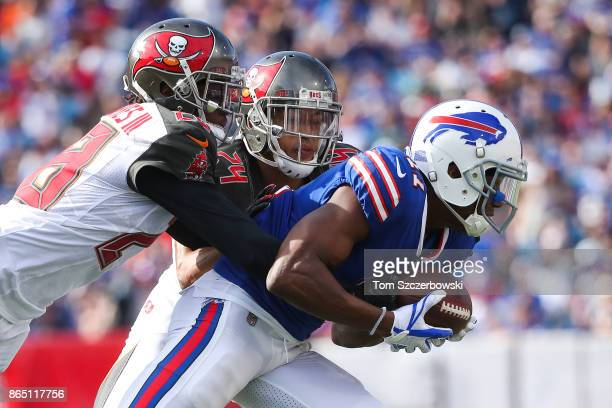 Vernon Hargreaves of the Tampa Bay Buccaneers and Brent Grimes of the Tampa Bay Buccaneers tackle Zay Jones of the Buffalo Bills during the second...