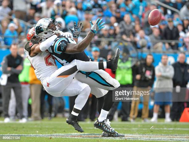 Vernon Hargreaves of the Tampa Bay Buccaneers tackles Ed Dickson of the Carolina Panthers during their game at Bank of America Stadium on December 24...