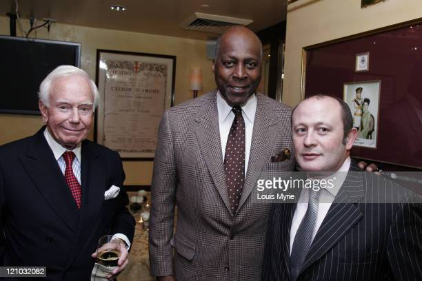 Vernon Jordan , guest, and Franco Nuschese , Cafe Milano owner