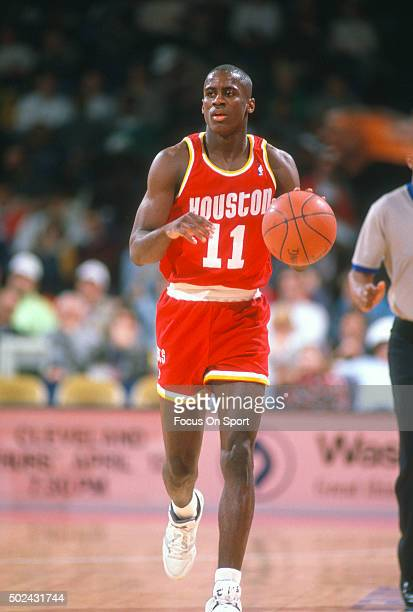 Vernon Maxwell of the Houston Rockets dribbles the ball up court against the Washington Bullets during an NBA basketball game circa 1990 at the...