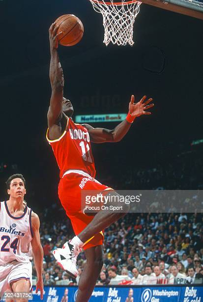 Vernon Maxwell of the Houston Rockets goes up for a layup against the Washington Bullets during an NBA basketball game circa 1994 at the US Airway...
