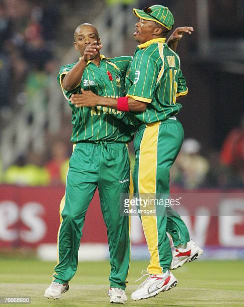 Vernon Philander and Makhaya Ntini of South Africa celebrate the wicket of Devon Smith for 35 runs during the ICC Twenty20 Cricket World Cup match...