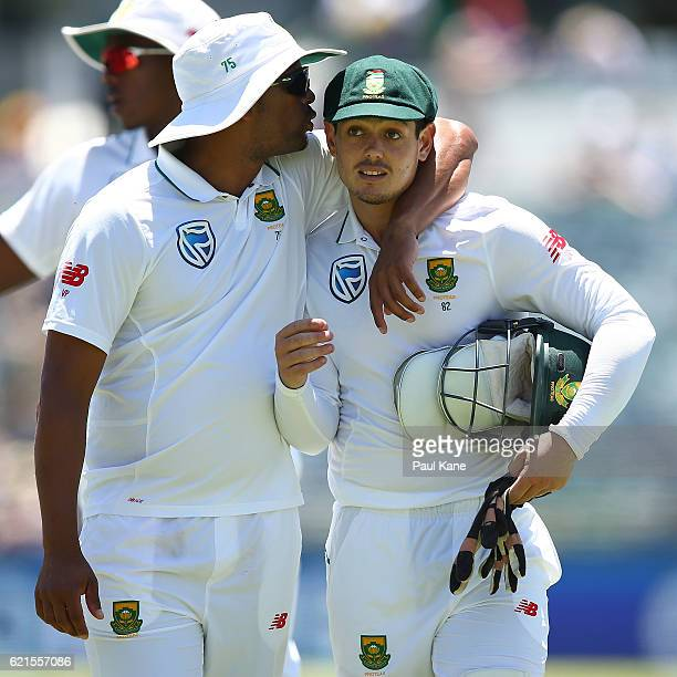 Vernon Philander and Quinton de Kock of South Africa walk from the ground at the lunch break during day five of the First Test match between...