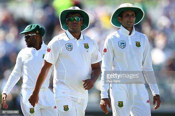 Vernon Philander Keshav Maharaj of South Africa walk from the field at the end of the Australian 1st innings during day two of the First Test match...