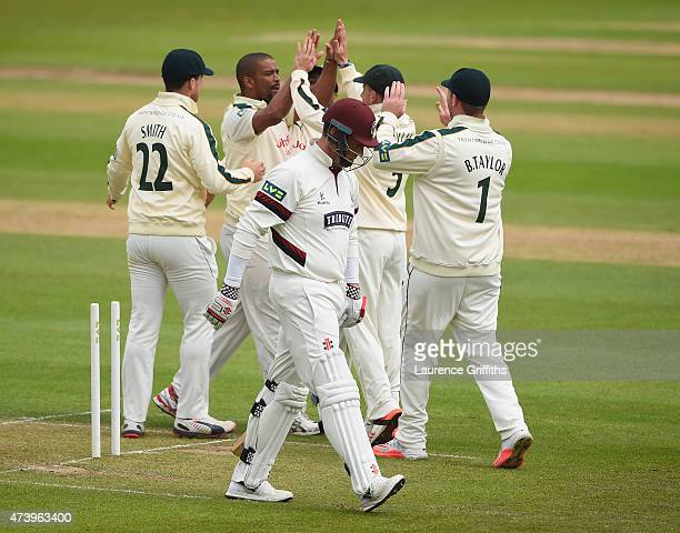 Vernon Philander of Nottinghamshire is congratulated on taking the wicket of Marcus Trescothick of Somerset during the LV County Championship match...