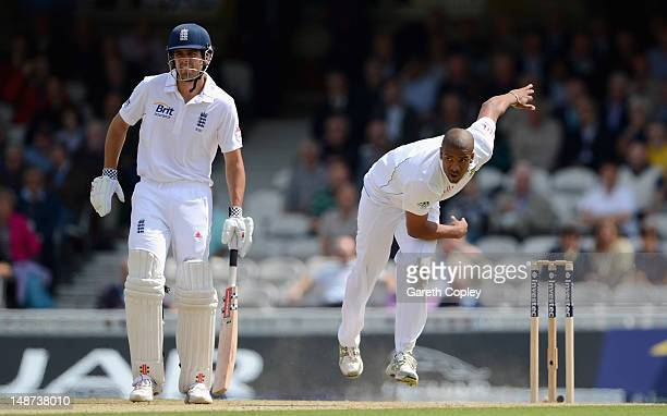 Vernon Philander of South Africa bowls alongside Alastair Cook of England during day one of the 1st Investec Test match between England and South...