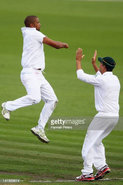 Vernon Philander of South Africa celebrates after claiming the wicket of Doug Bracewell of New Zealand during day one of the First Test match between...