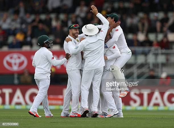 Vernon Philander of South Africa celebrates after taking the wicket of Adam Voges of Australia during day one of the Second Test match between...