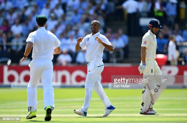 Vernon Philander of South Africa celebrates after taking the wicket of Alastair Cook of England during day one of the 1st Investec Test Match between...