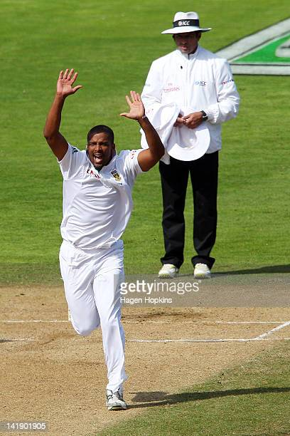 Vernon Philander of South Africa celebrates taking the wicket of Martin Guptill of New Zealand during day four of the Third Test match between New...