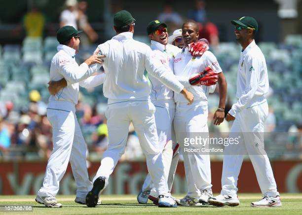 Vernon Philander of South Africa celebrates taking the wicket of David Warner of Australia during day four of the Third Test Match between Australia...