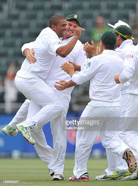 Vernon Philander of South Africa celebrates the wicket of Shane Watson of Australia for a duck off the second ball of the innings during day four of...