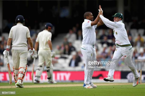Vernon Philander of South Africa celebrates with his team mate after bowling Joe Root of England out during Day One of the 3rd Investec Test match...