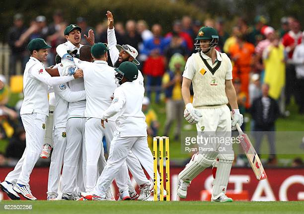 Vernon Philander of South Africa celebrates with team mates after taking the wicket of Adam Voges of Australia during day one of the Second Test...