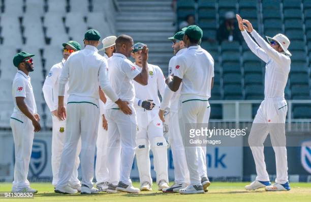 Vernon Philander of South Africa celebrates with teammates after taking a wicket during day 5 of the 4th Sunfoil Test match between South Africa and...