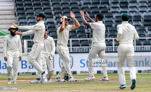 Vernon Philander of South Africa celebrates with teammates during day 4 of the 3rd Castle Lager Test match between South Africa and Pakistan at...