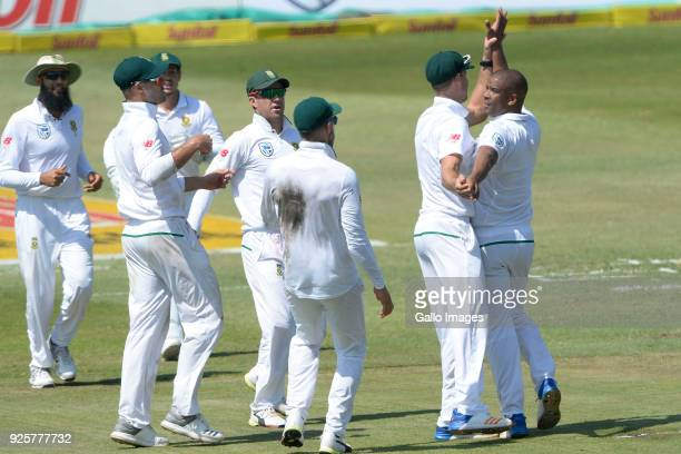 Vernon Philander of the Proteas celebrates the wicket of Cameron Bancroft of Australia with his team mates during day 1 of the 1st Sunfoil Test match...