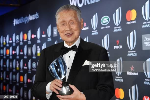 Vernon Pugh Award for Distinguished Service winner Japan's former prime minister Yoshiro Mori poses with his trophy during the World Rugby Awards on...