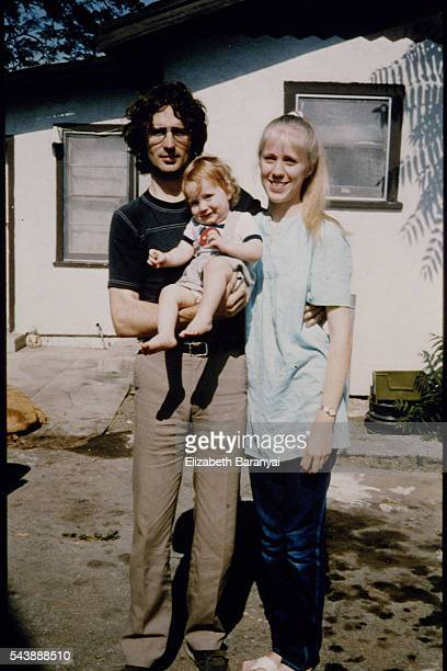 Vernon Wayne Howell known as David Koresh his wife Rachel and their son Cyrus in front of their house
