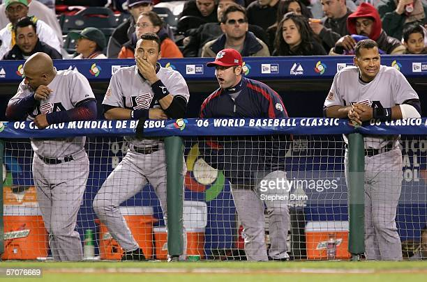 Vernon Wells, Derek Jeter, Brian Schneider and Alex Rodriguez of Team USA look on from the dugout during the Round 2 Pool 2 Game of the World...