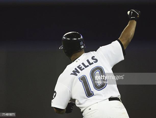 Vernon Wells of the Toronto Blue Jays celebrates his game-winning solo home run for a 5-4 win over the New York Yankees in the bottom of the 11th...
