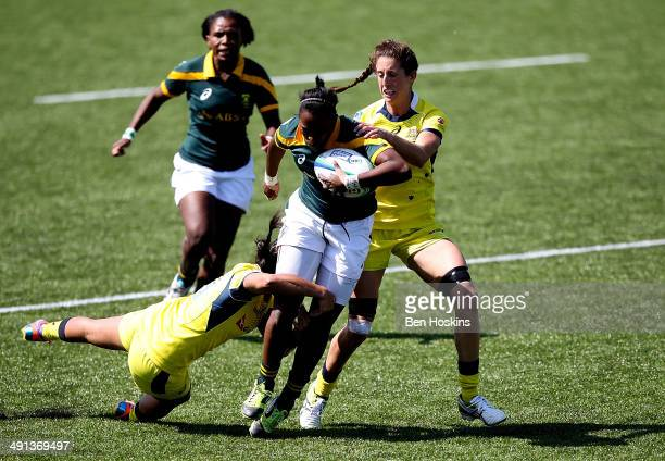 Veroeshka Grain of South Africa is tackled by Amy Turner of Australia during the IRB Womens Sevens match between Australia and South Africa on May 16...