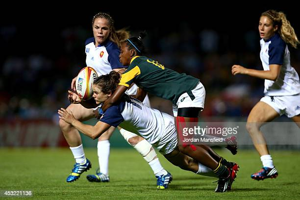 Veroeshka Grain of South Africa tackles Camille Grassineau of France during the IRB Women's Rugby World Cup Pool C match between France and South...