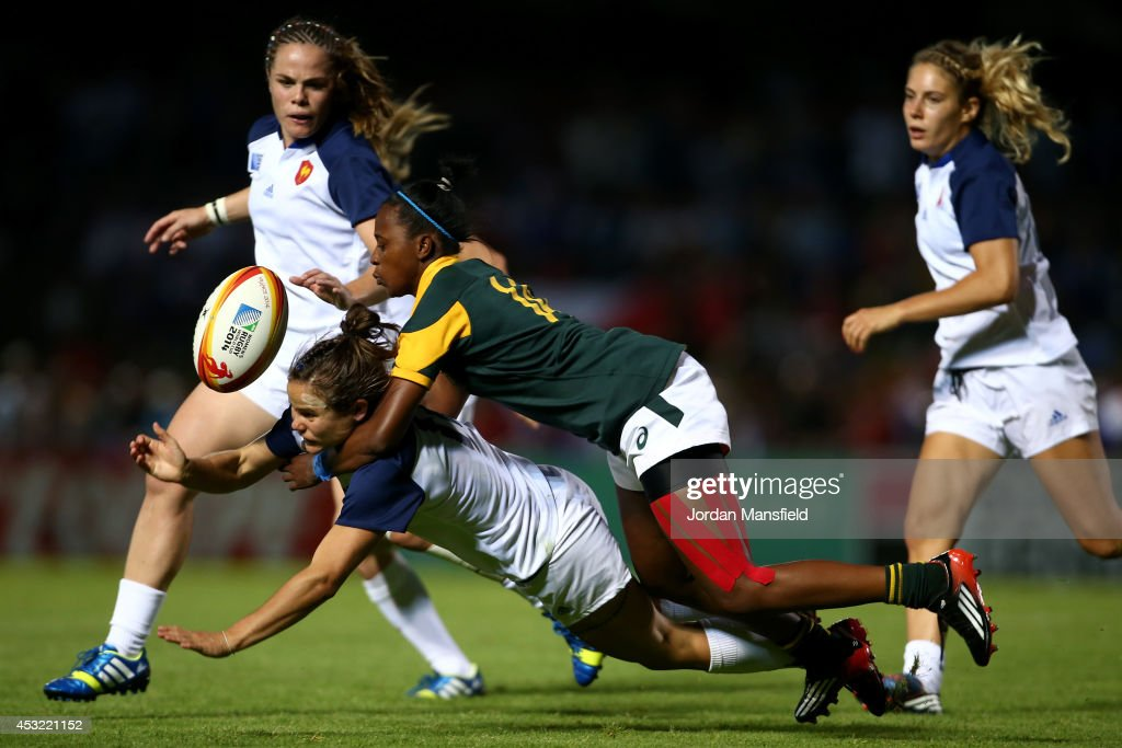 Veroeshka Grain of South Africa tackles Camille Grassineau of France during the IRB Women's Rugby World Cup Pool C match between France and South Africa at the French Rugby Federation headquarters on August 5, 2014 in Paris, France.