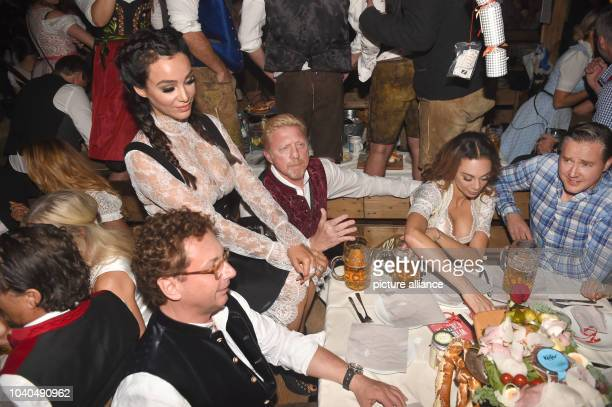 Verona and Franjo Pooth and Boris and Lilly Becker pose for the photographers on the first evening of the Wiesn in the Kaeferzelt beer tent in...