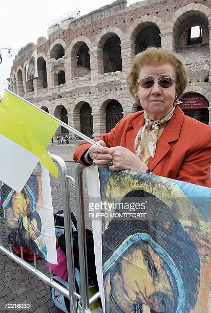 A woman waits for Pope Benedict XVI in front of the Verona Arena 19 October 2006 Pope Benedict XVI is in the northern city of Verona to address a...