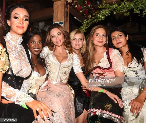 Verona Pooth dancers Motsi Mabuse and Lilly Becker celebrate in the Kaeferzelt beer tent on the first evening of the Wiesn in MunichGermany 17...
