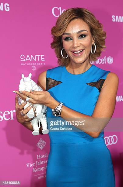 Verona Pooth with Karl Lagerfeld rhino attends the CLOSER Magazin Hosts SMILE Award 2014 at Hotel Vier Jahreszeiten on November 4 2014 in Munich...