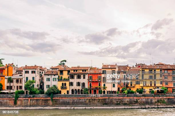 verona skyline with old houses along adige river waterfront, veneto, italy - townscape stock pictures, royalty-free photos & images