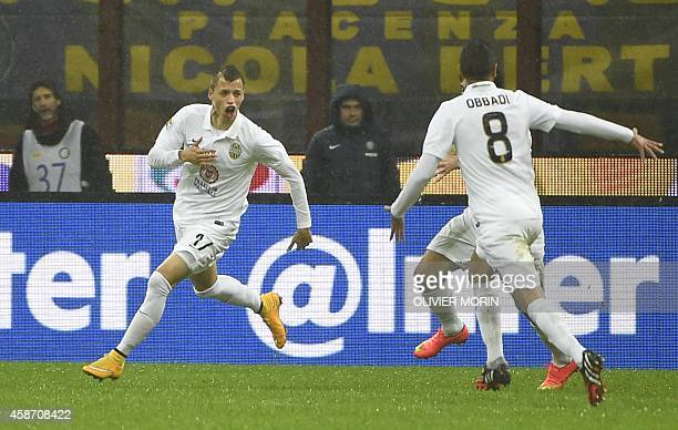 Verona's defender from Spain Antonio Luna celebrates after scoring during the Italian Serie A football match Inter Milan vs Verona on November 9 2014...