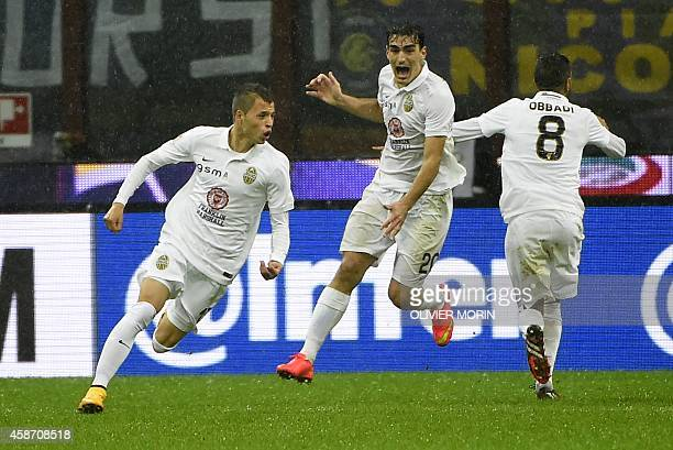 Verona's defender from Spain Antonio Luna celebrates with teammates after scoring during the Italian Serie A football match Inter Milan vs Verona on...