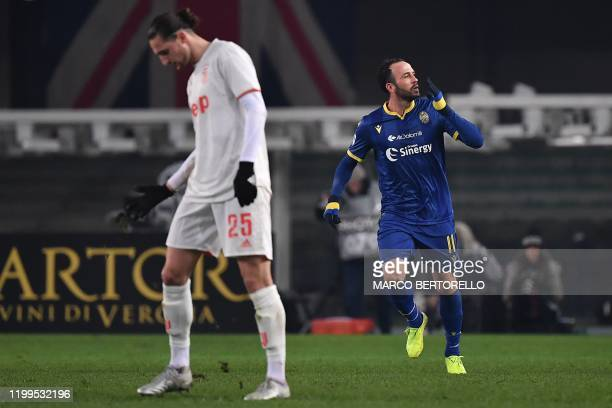 Verona's forward Giampaolo Pazzini from Italy celebrates after scoring a goal during the Italian Serie A football match Hellas Verona vs Juventus on...