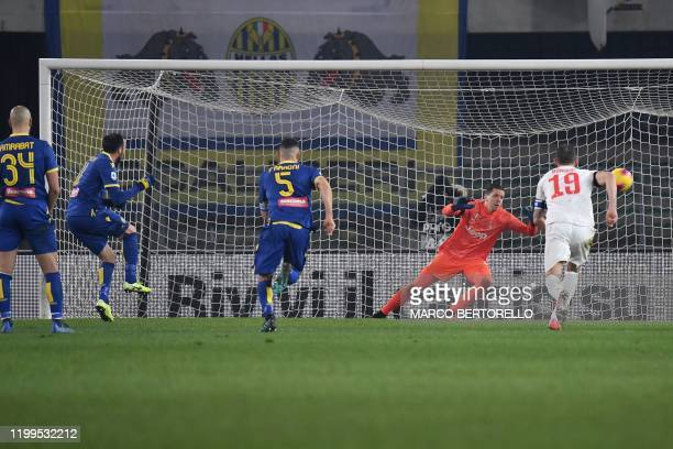 Verona's forward Giampaolo Pazzini from Italy scores a from penalty-kick during the Italian Serie A football match Hellas Verona vs Juventus on...