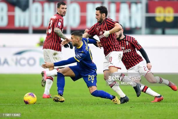 Verona's Italian midfielder Mattia Zaccagni outruns AC Milan's Turkish forward Hakan Calhanoglu during the Italian Serie A football match AC Milan vs...