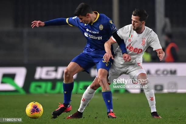 Verona's midfielder Matteo Pessina from Italy fights for the ball with Juventus' midfielder Miralem Pjanic of BosniaErzegovina during the Italian...