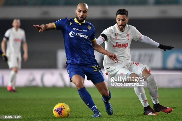 Verona's Moroccan midfielder Sofyan Amrabat vies for the ball with Juventus' Uruguayan midfielder Rodrigo Bentancur during the Italian Serie A...