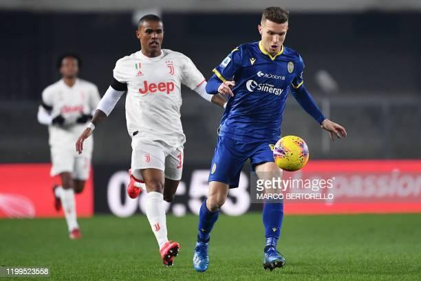 Verona's Serbian midfielder Darko Lazovic vies for the ball with Juventus' Brazilian midfielder Douglas Costa during the Italian Serie A football...