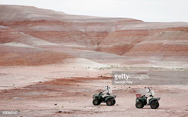 Veronica Ann ZabalaAliberto from Arizona State University and Hugh Gregory a spaceflight historian ride their ATV's on an exploration trip near the...