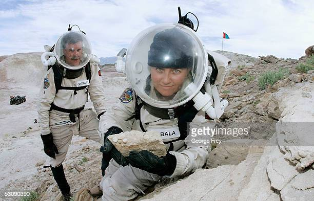 Veronica Ann ZabalaAliberto from Arizona State University shows a rock with round concretions on it as Hugh Gregory a spaceflight historian looks on...